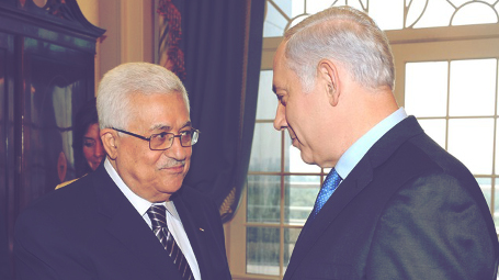 Netanyahu and Abbas shaking hands. Photo: GPO